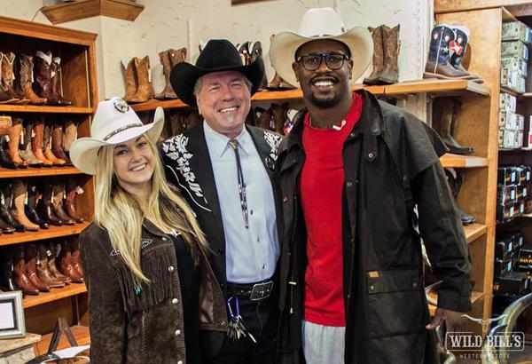 Lindsay Arnold, Bill Dewbre and Von Miller at Wild Bill's Western Store