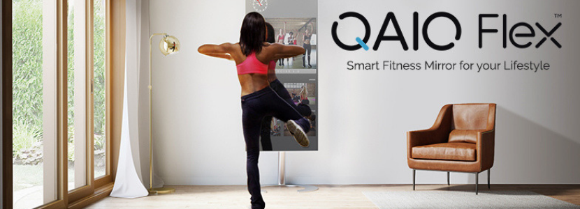 A woman doing his workout using QAIO Flex Fitness Mirror