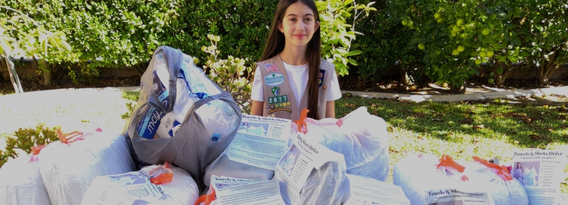 Orange County teenager and Girl Scout continues working to help homeless through COVID-19 lockdown.