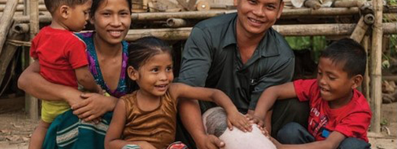 A family with a donated pig provided through GFA's Christmas gift catalogue.