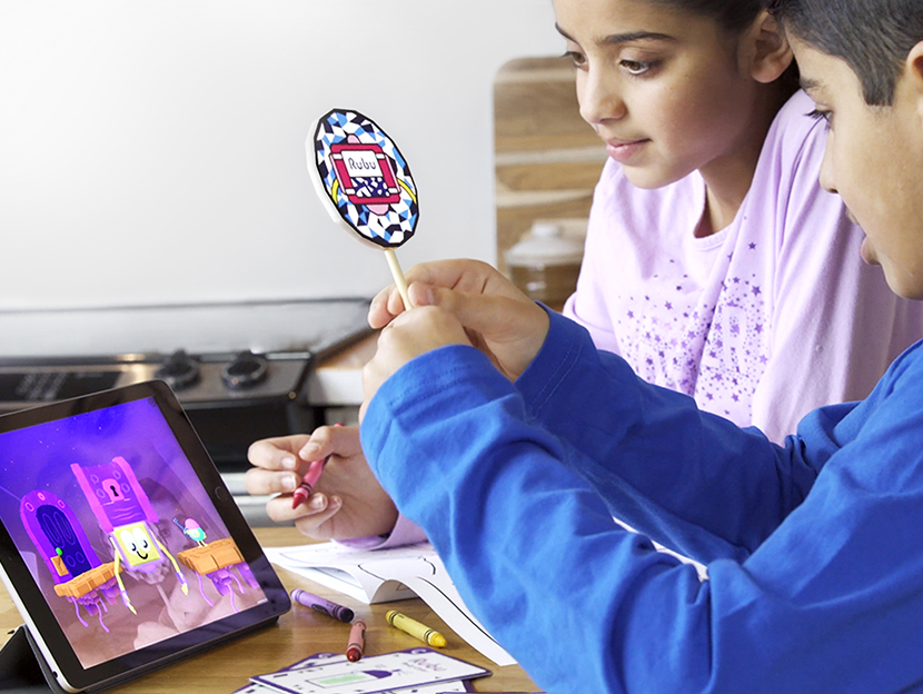 Kids 5 to 8 playing with the augmented reality puppets included in the Rubu Adventure Kit