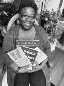 Jami Fowler-White pictured with 4 books she published over the past year.