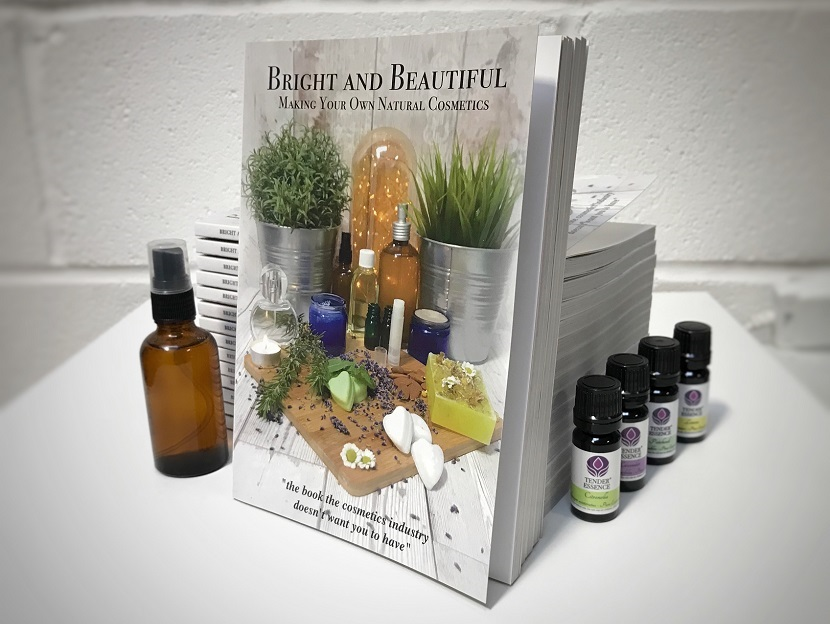 Bright and Beautiful - Making Your Own Natural Cosmetics book stack with essential oils