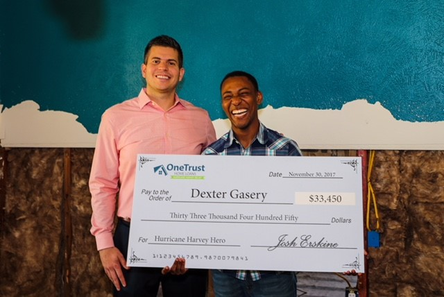 Veteran Dexter Gasery receives donation check from CEO of OneTrust Home Loans, Josh Erskine